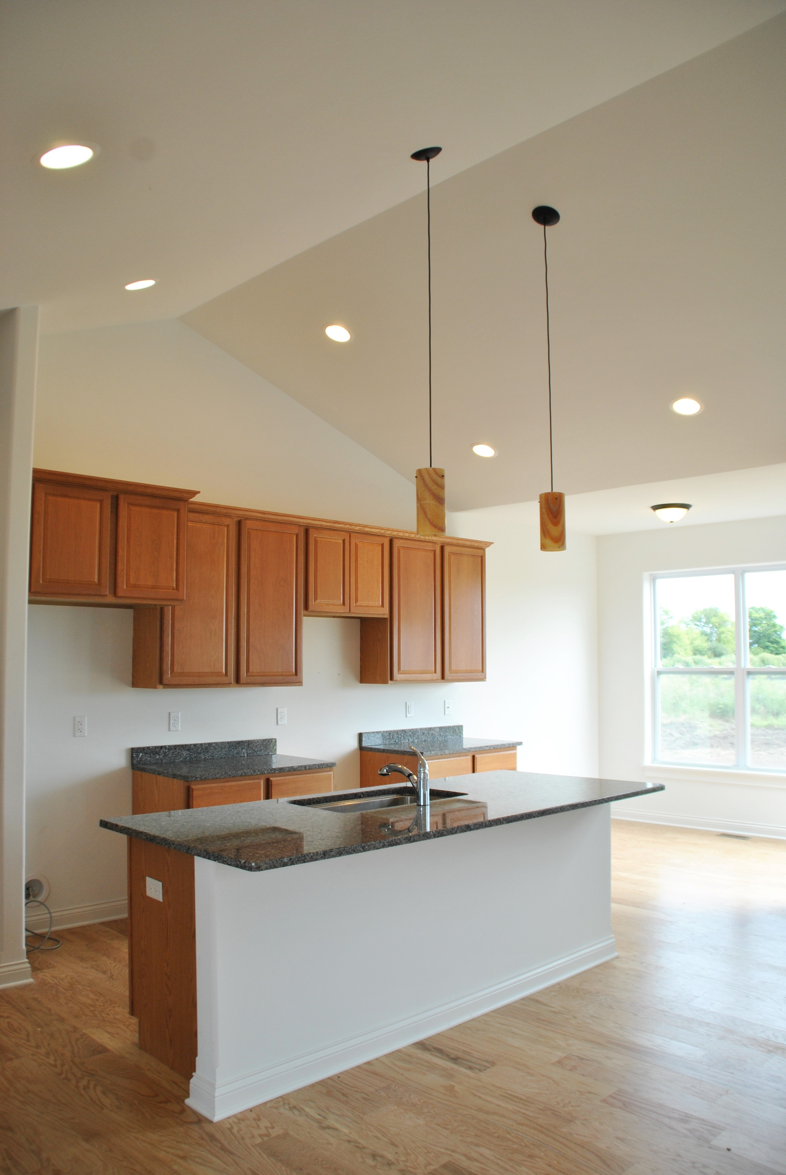kitchen with light colored floor and oak cabinets