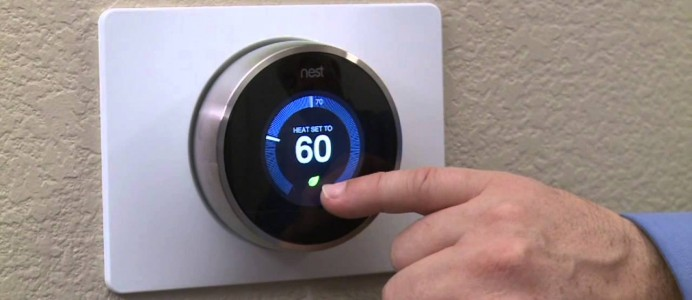 Person adjusting their nest thermostat