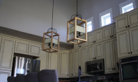 Pendant lights hanging above a kitchen bar island