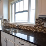 Featuring a black granite countertop