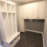 White mudroom bench with three locker slots
