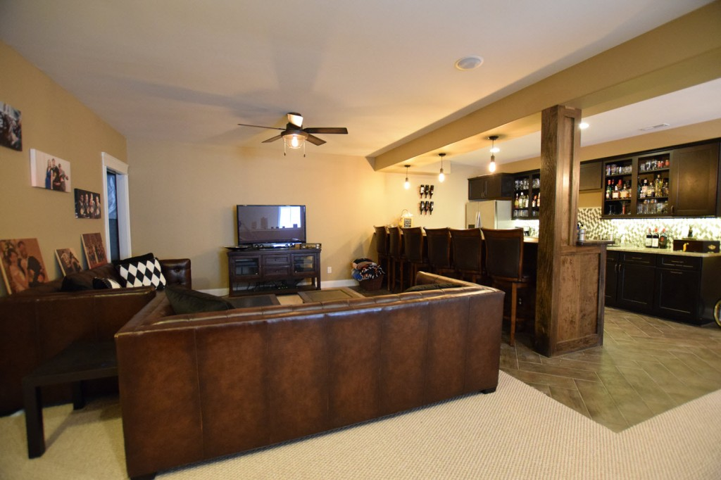 Finished basement with leather couches