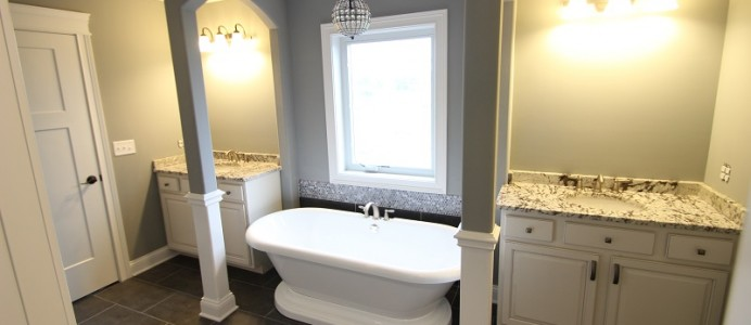 Soaker tub centered below large bay window