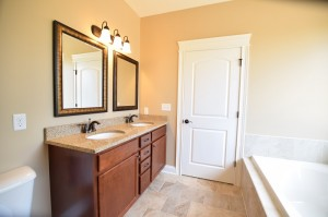 Two, square wall-mount mirrors with brown frames