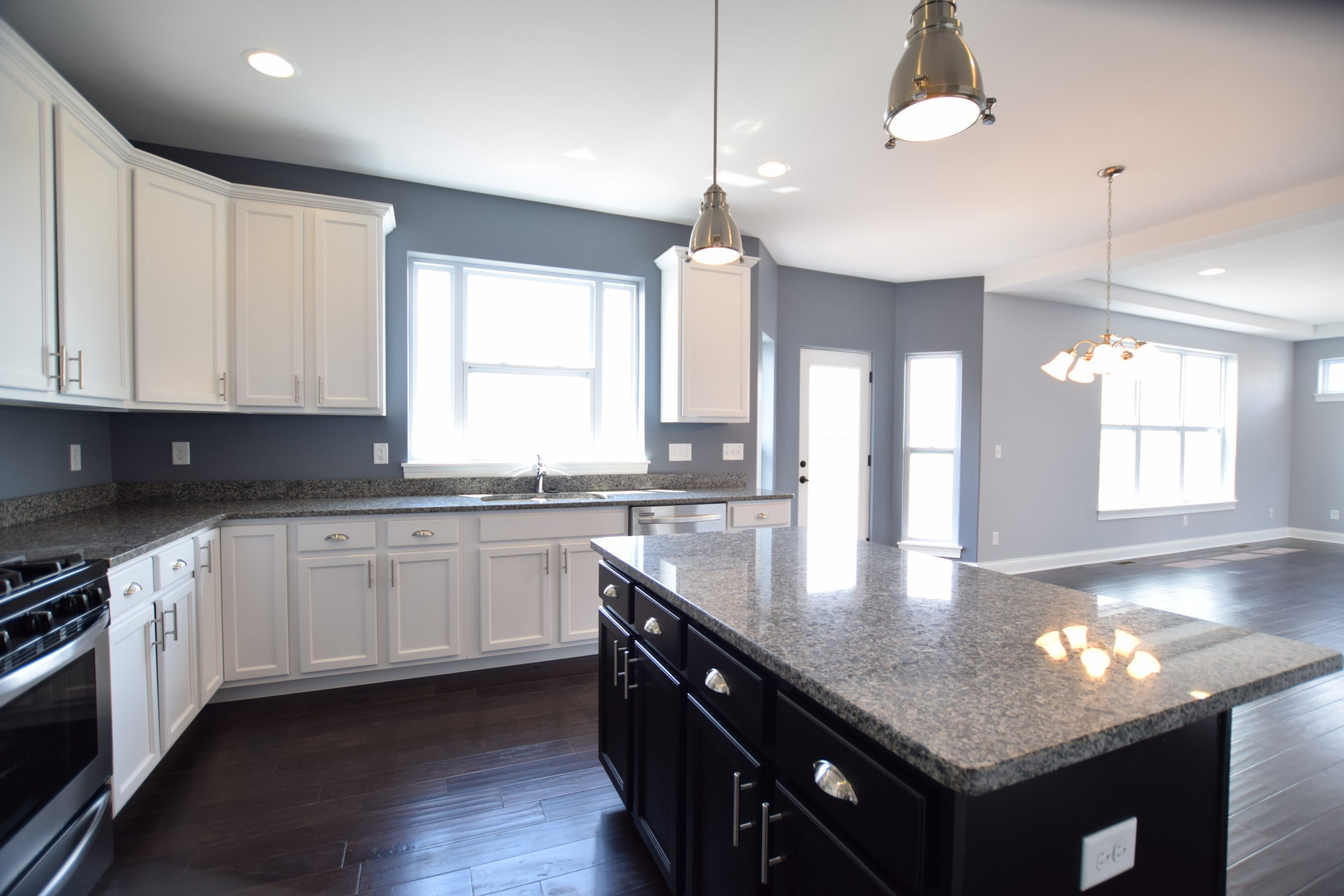 Kitchen with white and black cabinets