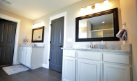 bathroom with framed mirrors