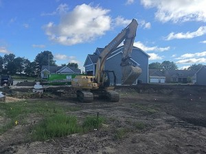Backhoe about to dig a hole in ground