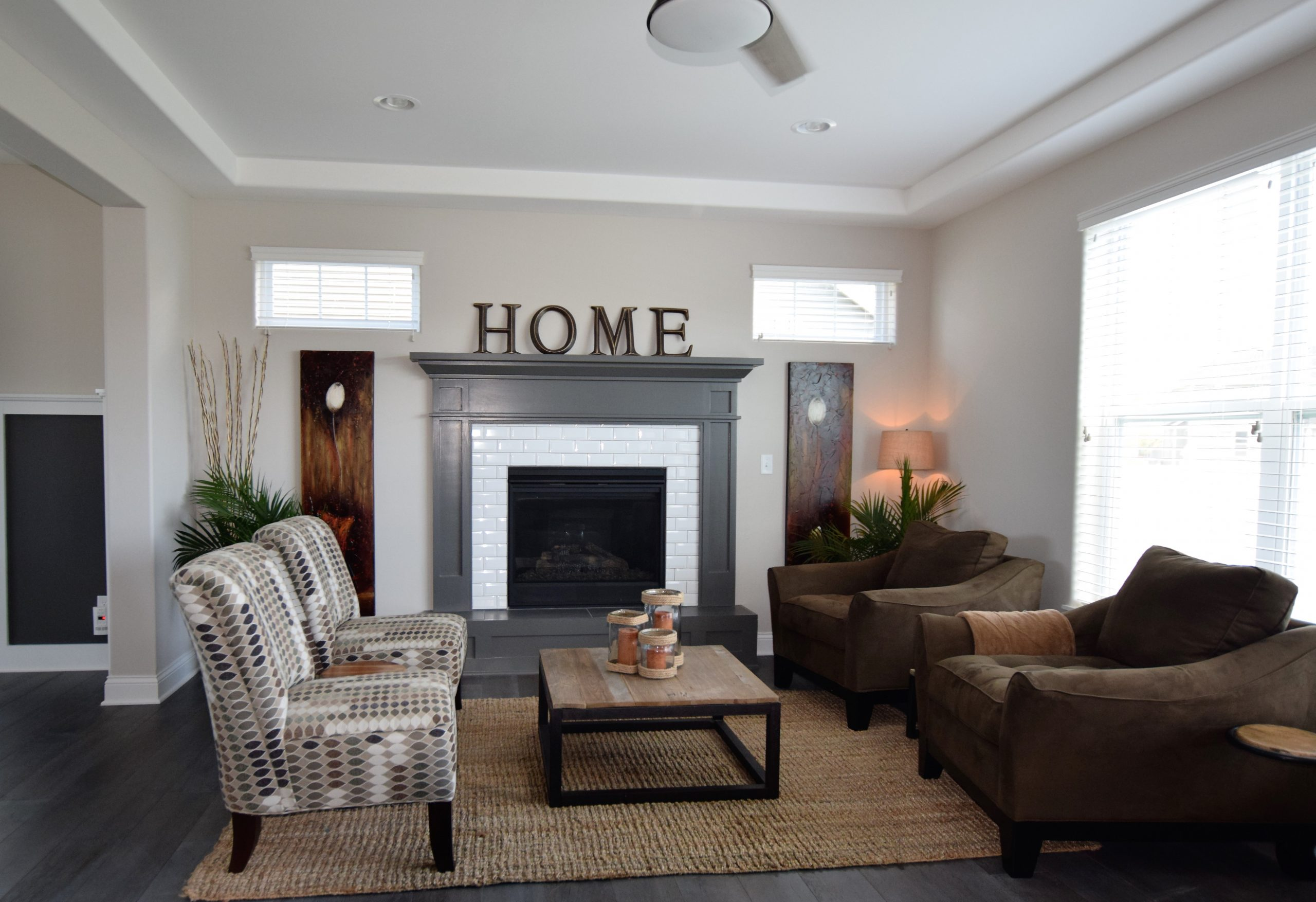 Fireplace with gray mantel and white tile surround