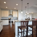 custom kitchen with white cabinets and dark metal hardware
