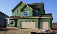 Two-story home with green zip system