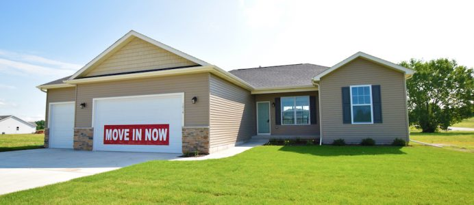 """Front exterior of a ranch style home with sign reading """"move in now"""""""