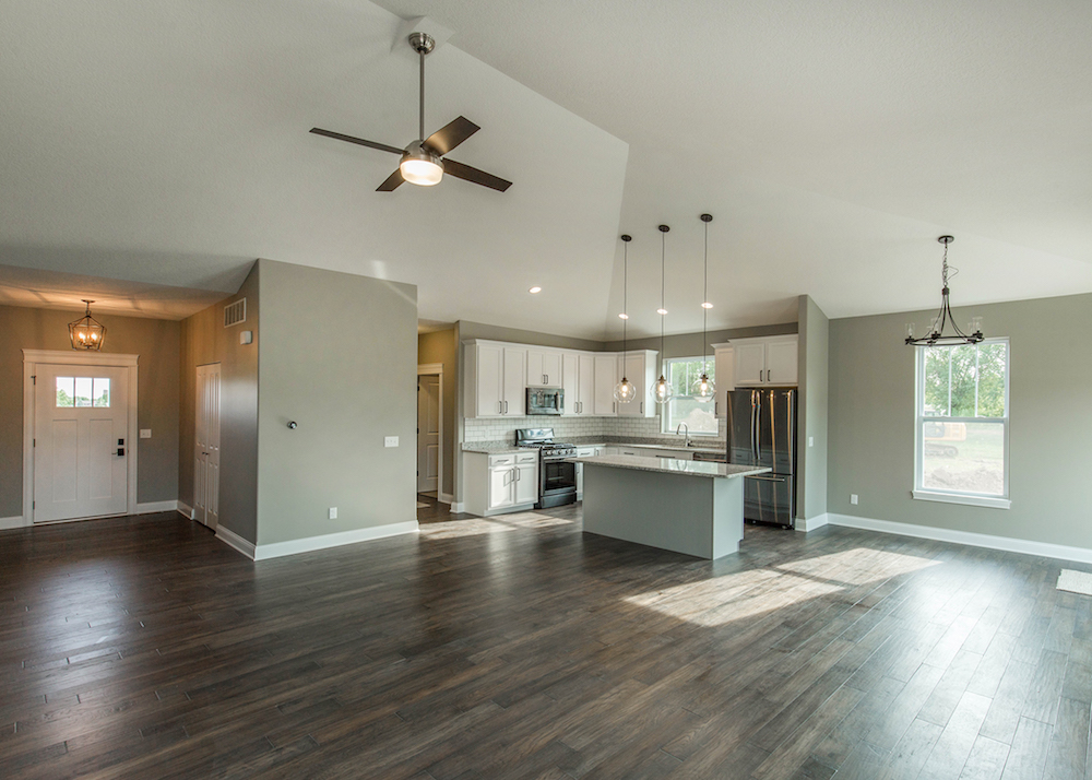 Great room and kitchen with light hardwood floor