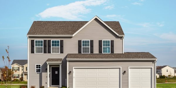 Front exterior of a 2-story floor plan with three car garage, brown siding, and a dark brown room.